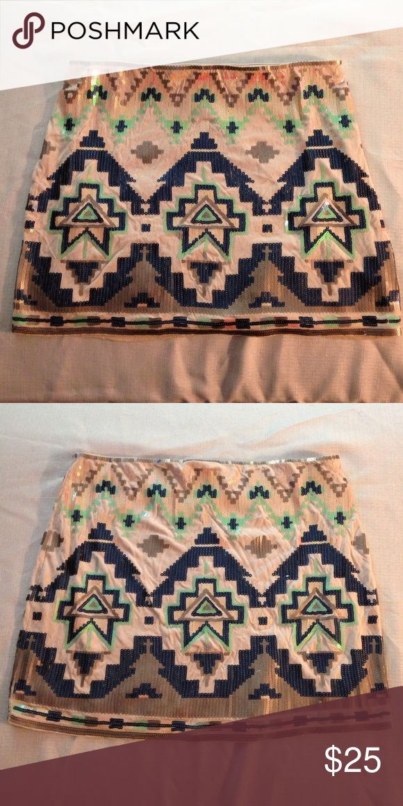 Express Aztec sequin skirt Express Aztec sequin skirt in blush, green, royal blue, and grey. Size small. Only worn once. Express Skirts Mini