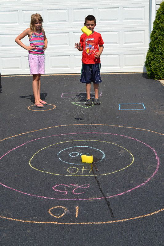 A couple sponges and a box of chalk are all you need to turn your driveway into a bullseye target game.