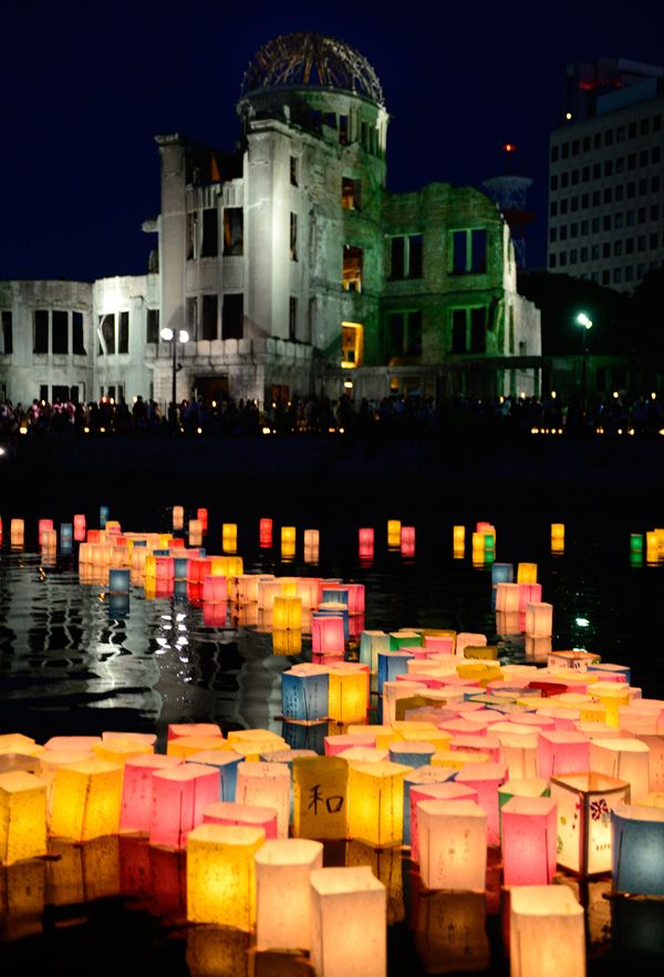 Paper lanterns lit in remembrance for victims of the 1945 atomic bombing of Hiroshima float on the Motoyasu River in front of the Atomic Bomb Dome at the Peace Memorial Park in Hiroshima, western Japan, on August 6. Tens of thousands gathered at the park in Hiroshima to mark the 68th anniversary of the U.S. atomic bombing of the city.