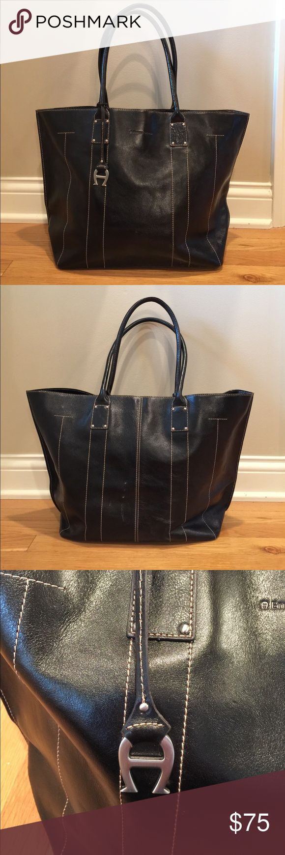 Etienne Aigner Handbag Etienne Aigner black handbag with detailed stitching. Small scuff on back of back (pictured). Excellent condition. Etienne Aigner Bags Totes