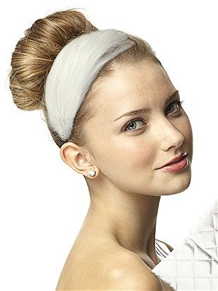 The hairstyle of choice for ballerinas, the simple bun is updated with a feather-trimmed headband with crystal accent straight out of Swan Lake. The Dessy Group, available at Ida's Bridal Shop, Torrington.