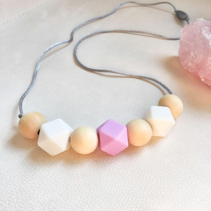 "Thanks for the kind words! ★★★★★ ""Beautiful Silicone teething necklace, my niece loved it. "" Monic http://etsy.me/2jM2pC3 #etsy #accessories #mothersday #siliconeteething #babyshoweridea #siliconenecklace #babyshowergift #teethingrelief #siliconebeads #naturalwood"
