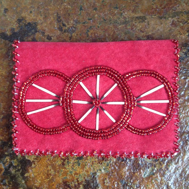 A personal favorite from my Etsy shop https://www.etsy.com/listing/450502964/red-porcupine-credit-card-holder