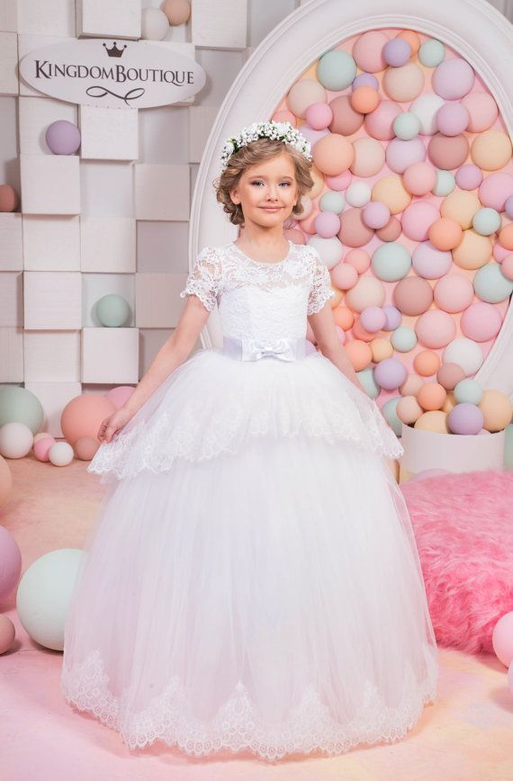 Please read our store policies before placing your order here https://www.etsy.com/ru/shop/Butterflydressua/policy Beautiful ivory flower girl dress with multilayered skirt, corset with lace applique and rhinestones, zipper and lacing, and satin stripe with bow. Item material: