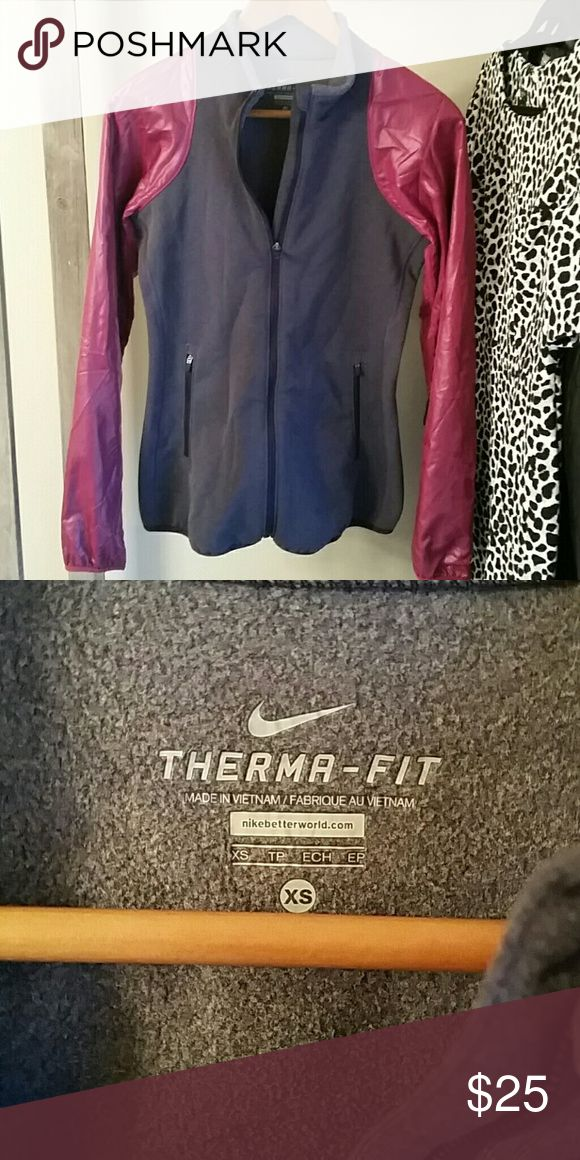 Womens Nike Therma-fit jacket Pink sleeves and a purple body.  Excellent condition.  Wrinkled from storage.  Size XS.  No marks or flaws to be found.  Two front functional pockets. And zips all the way down the front. Nike Jackets & Coats