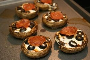 degrees. Clean mushrooms and scoop out the insides and stem with a spoon. Place on baking pan and bake for 7 minutes. While mushrooms are baking, grate Mozzarella, and combine in a bowl with one egg white. (Usually low-fat cheese has trouble melting, so this technique helps the cheese melt while adding a bit of protein.) Remove mushrooms from oven, and turn the broiler to High. On the mushrooms layer pizza sauce, cheese mixture, olives, and pepperoni slices. Return pan to oven and broil on…