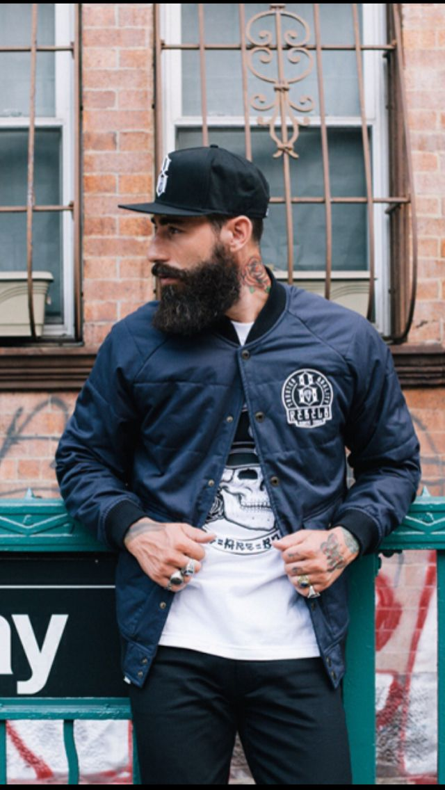 Hip. Men. Fashion. Outfit. Male. Clean. Street Style. Wear. Beard. Groomed. Black & White. Cap. Branded. Baseball. Jacket. Slim. Tattoo. Clothing. City.