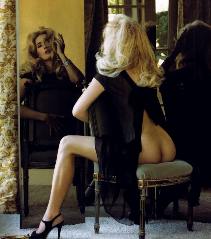 Kate Winslet bare bottom sitting in a chair facing her mirror