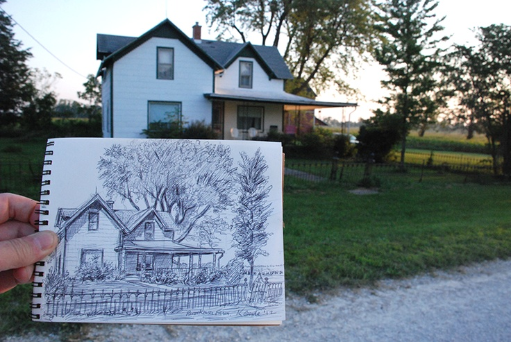 Holding my drawing of Indiana farm house. by Karl Gude