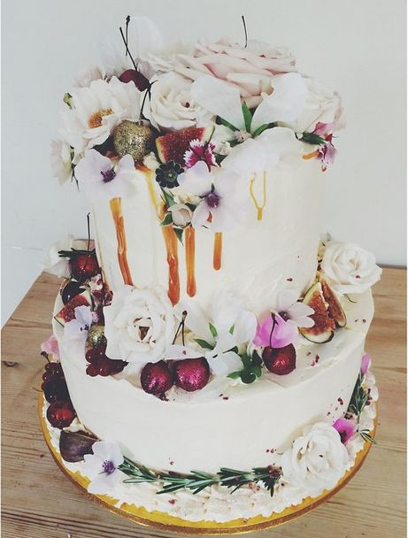 tiered cake with dripping caramel and real flower decorations