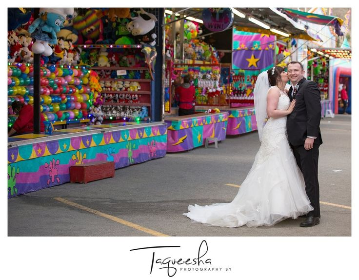Kamloops wedding photographer, Photography by Taqueesha. Wedding photos at a carnival, wedding at a fir, couple playing games.