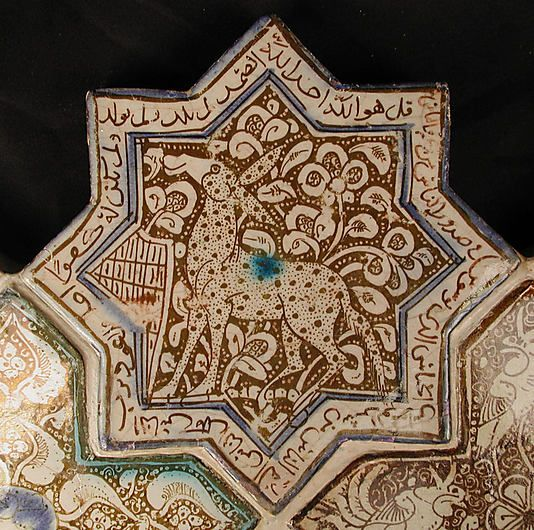 Star-Shaped Tile    Object Name:      Star-shaped tile  Date:      13th century  Geography:      Iran, Kashan  Medium:      Stonepaste; in-glaze painted in blue and turquoise and luster-painted on opaque white glaze  Dimensions:      6 1/2 in. (16.5 cm)  Classification:      Ceramics