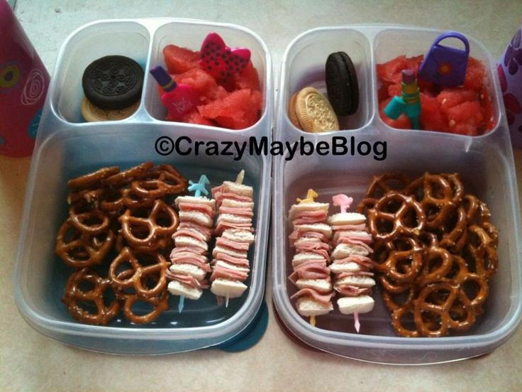 Ham sandwich stackers, pretzels, watermelon, cookies and milk