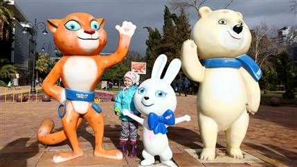 SOCHI, RUSSIA - FEBRUARY 01:  Fans pose with Olympic mascots in downtown Sochi prior to the Sochi 2014 Winter Olympics on February 1, 2014 i...