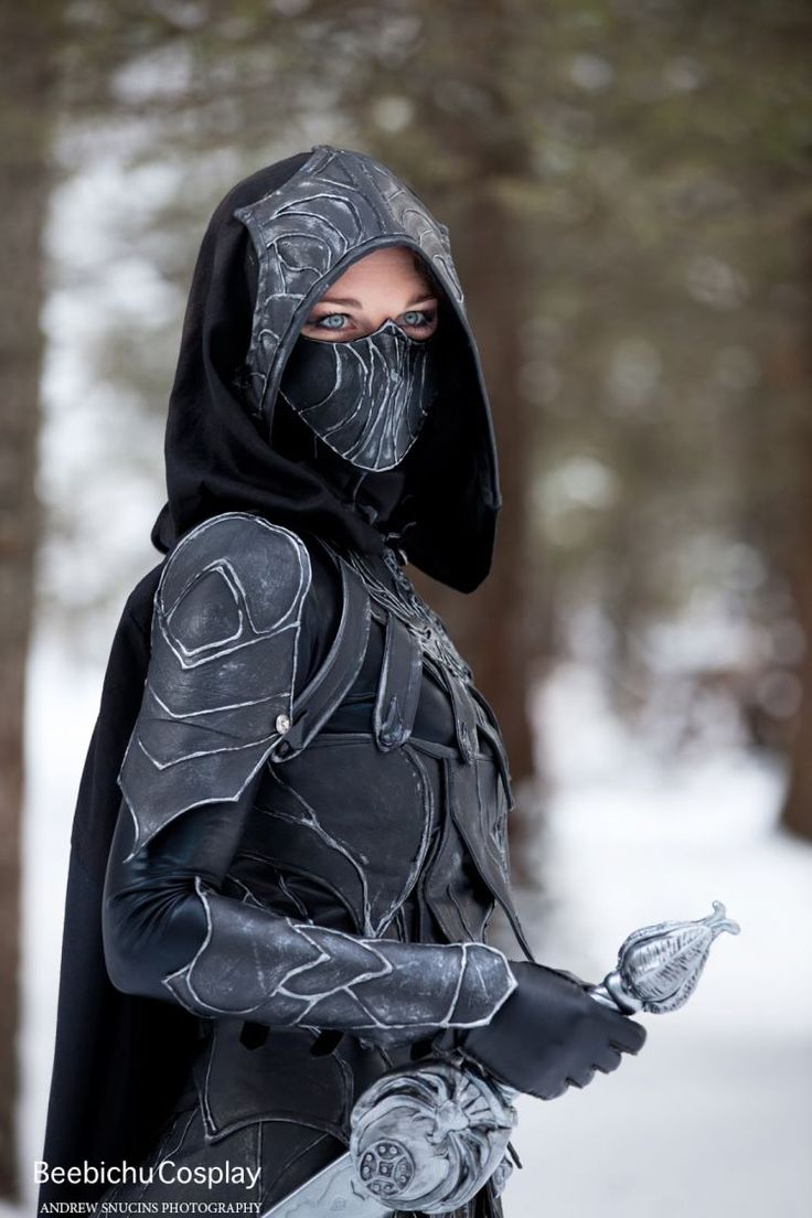Female in metal armor. No that's not metal and its a nightingale from skyrim