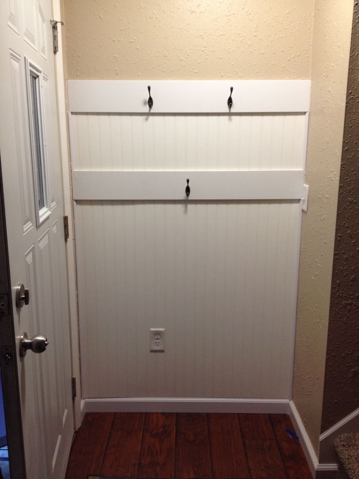 Added some function to our tiny entryway. Beadboard on the wall with hooks (for coats & bags)
