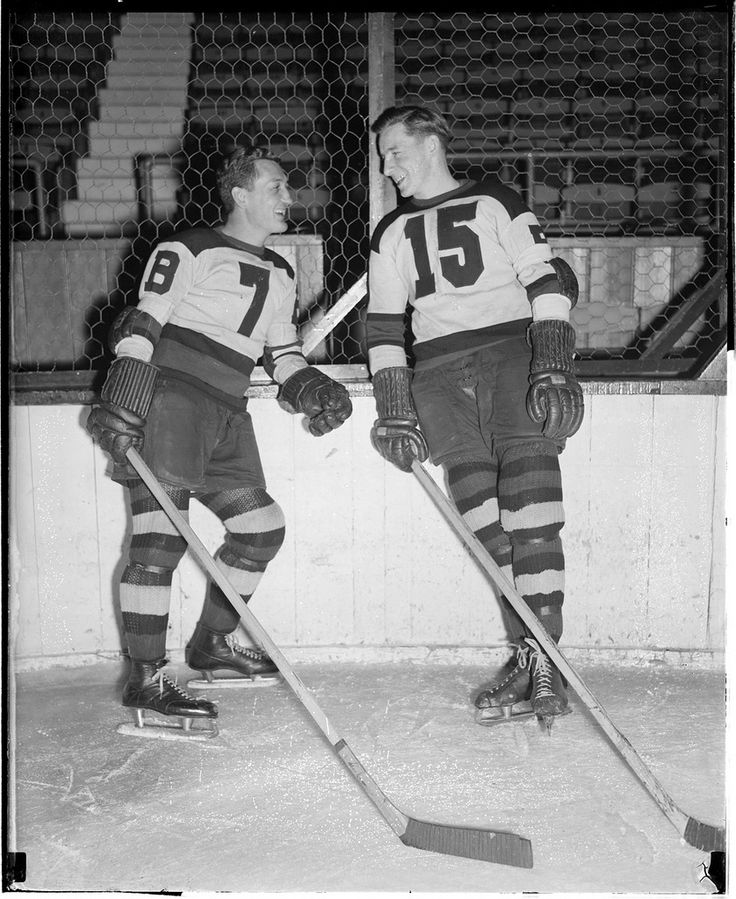 Pictures of old hockey players (link) I just like hockey players hehe :)