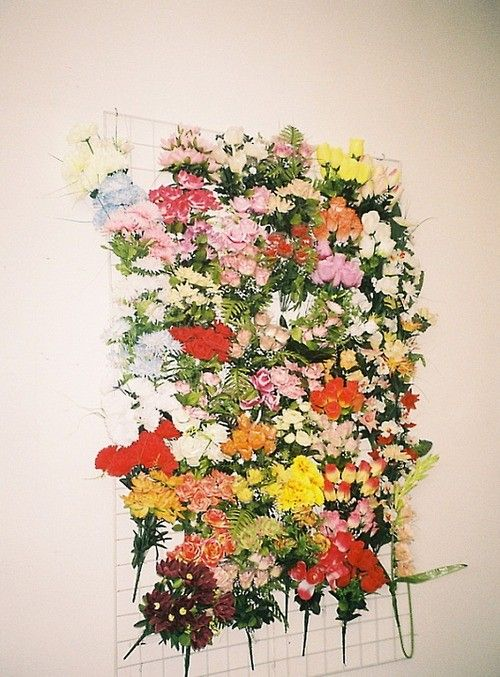 H: we could make a backdrop like this with chicken wire and florals.