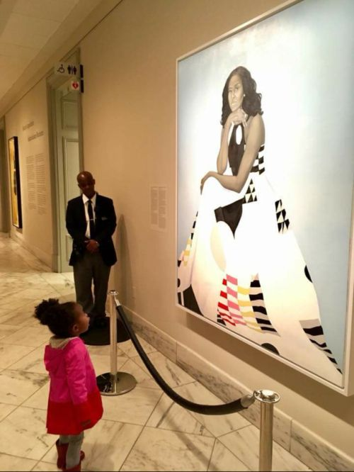 "The photo of Parker Curry staring at the recent portrait at the Smithsonian National Portrait Gallery went viral last week, garnering an invitation to Washington from Obama. ""Parker, I'm so glad I had the chance to meet you today (and for the dance party)! Keep on dreaming big for yourself...and maybe one day I'll proudly look up at a portrait of you,"" she tweeted. Parker, who viewed Obama's portrait with her mother, believed Michelle Obama was a queen."