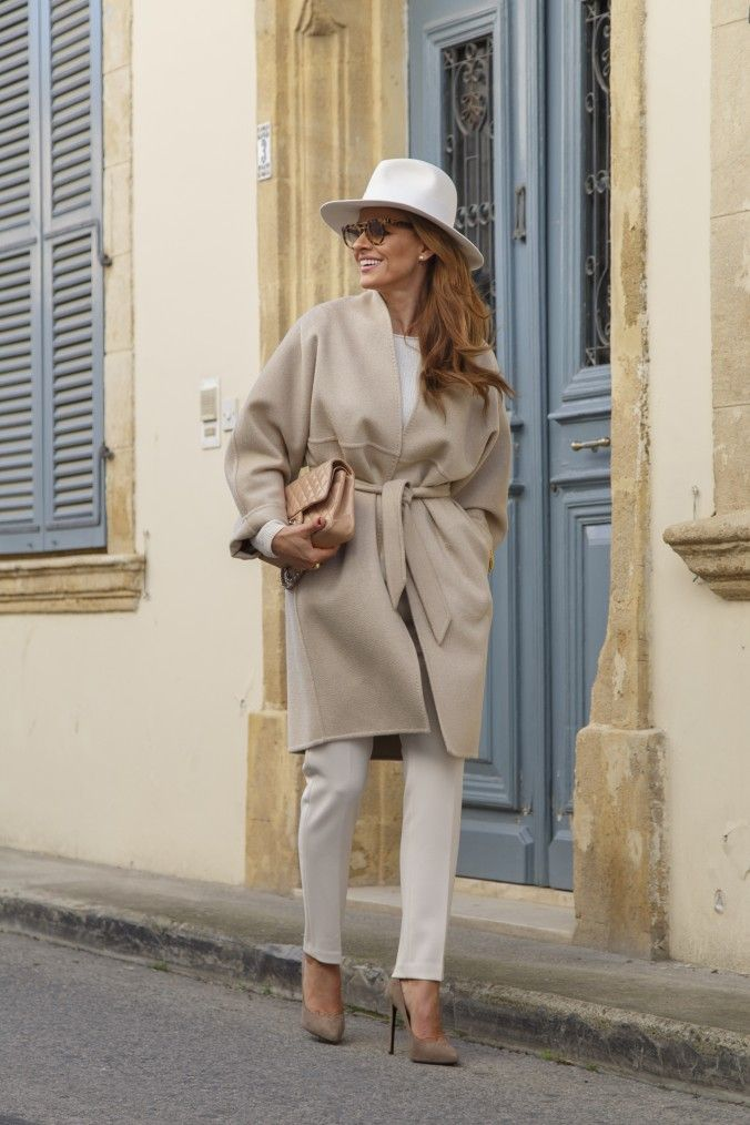 Coat : MaxMara Hat: Borsalino Shoes: Saint Laurent Bag : Chanel Shades : Prada Bag : RamonFilip