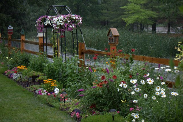 3 rail / split rail fence with wire will be perfect for the dog and flower gardening.