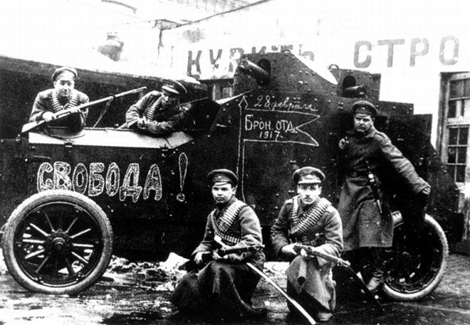 "A 1917 photograph showing soldiers of the interim Russian government (after the February revolution but before the Bolshevik Revolution of October/November) posing with an awfully familiar looking armoured car. The word chalked on the side of the hood is ""Freedom"". This Day in History: Mar 8, 1917: February Revolution begins http://dingeengoete.blogspot.com/"
