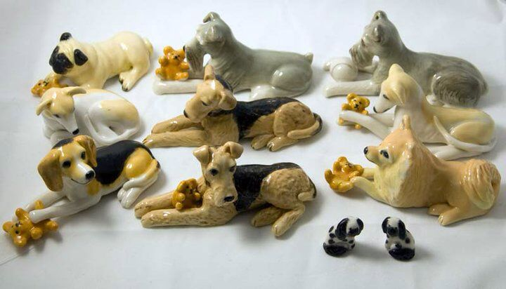 Ceramic dogs with their favourite toys