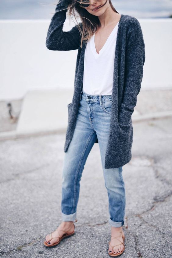 A charcoal open cardigan and light blue boyfriend jeans are a perfect combination to be utilised at the weekend. For footwear go down the casual route with cream leather thong sandals.   Shop this look on Lookastic: https://lookastic.com/women/looks/charcoal-open-cardigan-white-v-neck-t-shirt-light-blue-boyfriend-jeans/20948   — Charcoal Open Cardigan  — White V-neck T-shirt  — Light Blue Boyfriend Jeans  — Beige Leather Thong Sandals