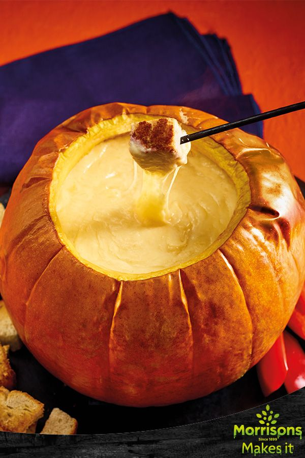 Witches Cauldron Roasted Pumpkin Cheese Fondue.  It wouldn't be Halloween without a little hocus pocus. A tasty, spellbinding recipe to enjoy with friends.