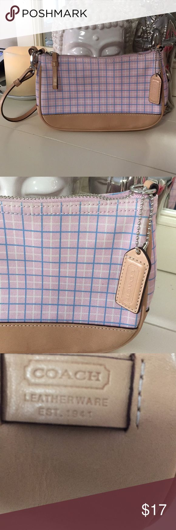 Coach plaid purse wristlet  with leather trim Coach plaid blush pink, blue and white plaid with beige trim leather. The strap can clip to one side or clip on to wear as purse. This Coach purse measures 8 1/4 inches across, 5 1/4 inches high and 2 1/4 inches wide Coach Bags Clutches & Wristlets