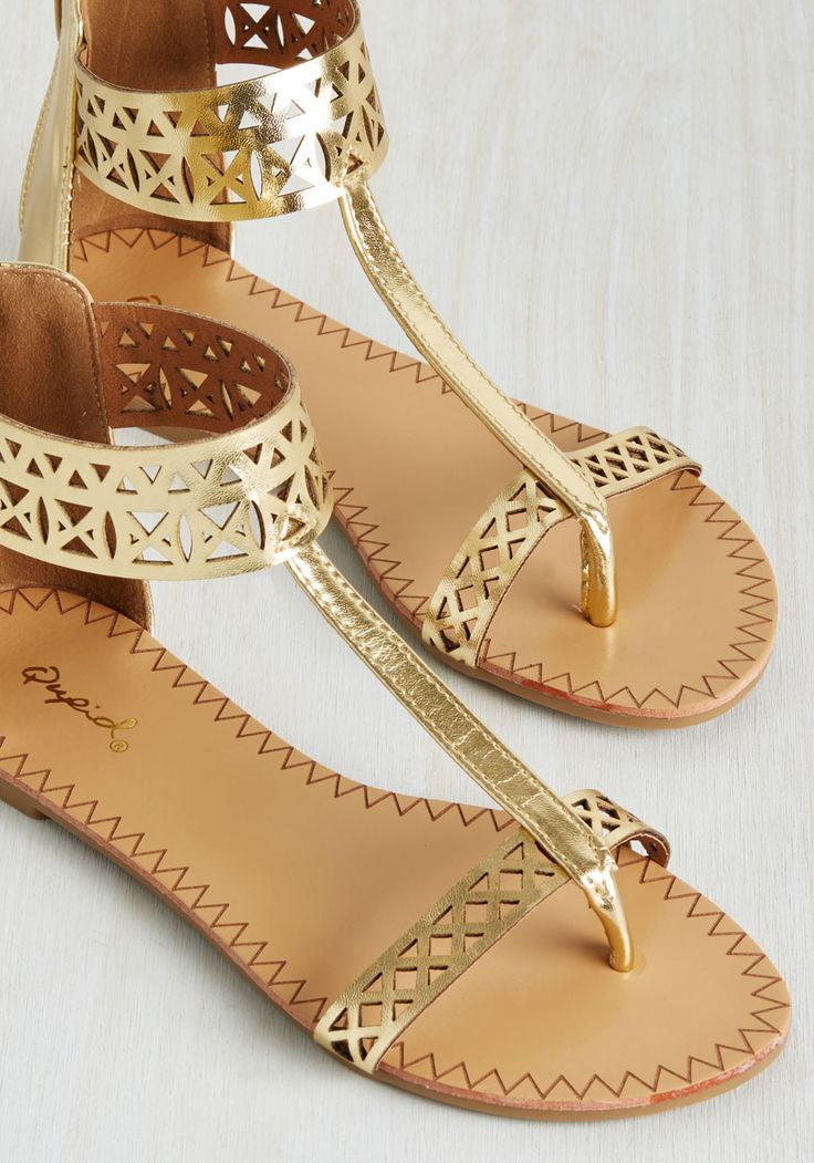 Notoriously Noticeable Sandal. These metallic gold sandals have a history of turning heads! #gold #modcloth