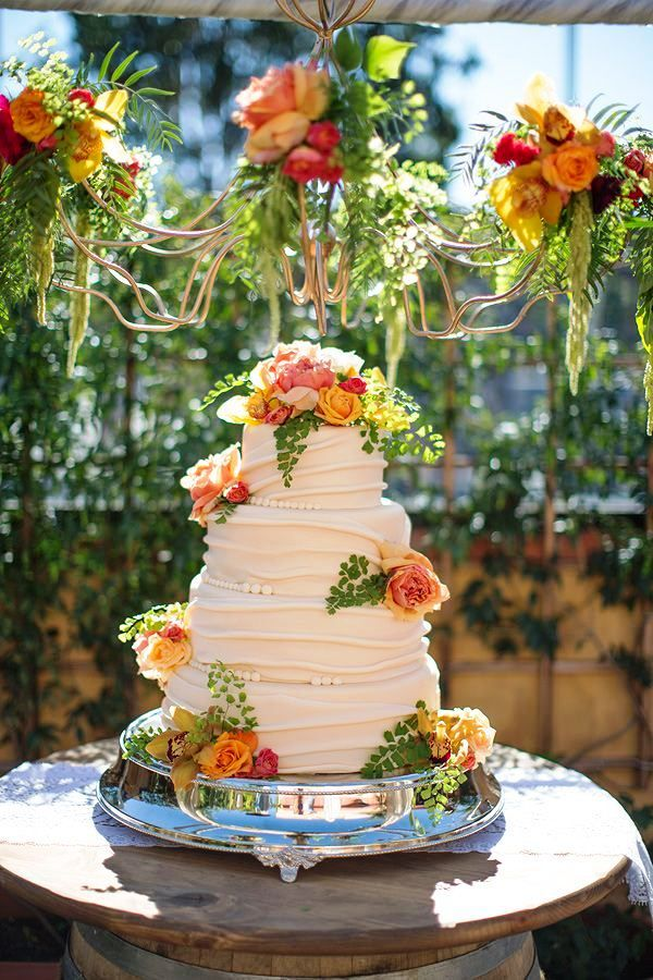 I'm loving this beautiful cake and the bright, warm colors of the flowers that adorn it.  So pretty!