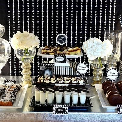 This amazing gangster themed party was inspired from the movie 'The Godfather'.  Naturally, all of the decor would be in black and white with touches of vintage items as well as mug shots and guns.  There were many offers you couldn't refuse at the delectable Italian themed dessert table.  All of the desserts had respective name tags such as Bonasera, Bonasera or Leave the Gun…Take the Cannoli.