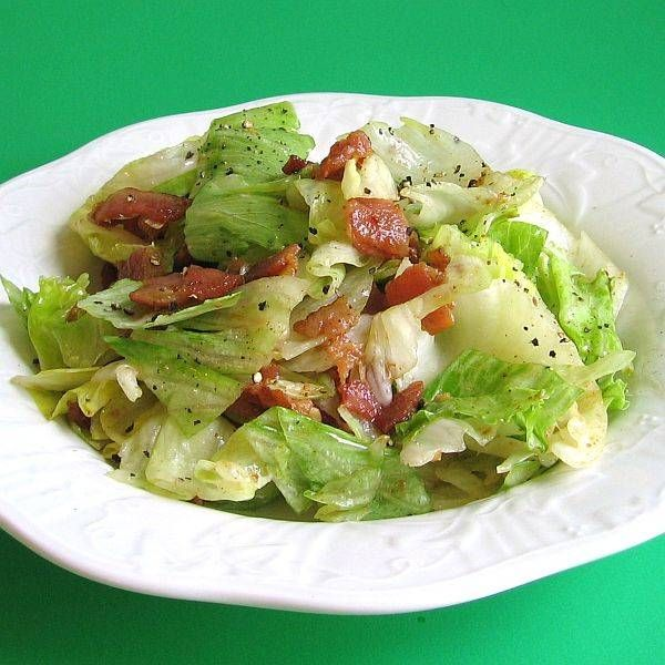 Wilted Lettuce Salad with Hot Bacon Dressing....Easy and really good!  I use Cider Vinegar for the apple flavor rather than the White Vinegar this recipe calls for and I don't skimp on the bacon either.  In other words, this salad has plenty of bacon in it.  sooooooo gooood!