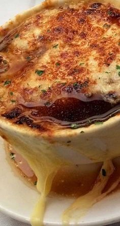 Recipe for Famous Barr French Onion Soup - This soup is thick and rich, bubbling with melted cheese atop two slices of French baguette. A truly iconic soup from St. Louis and the old Famous and Barr retail store.