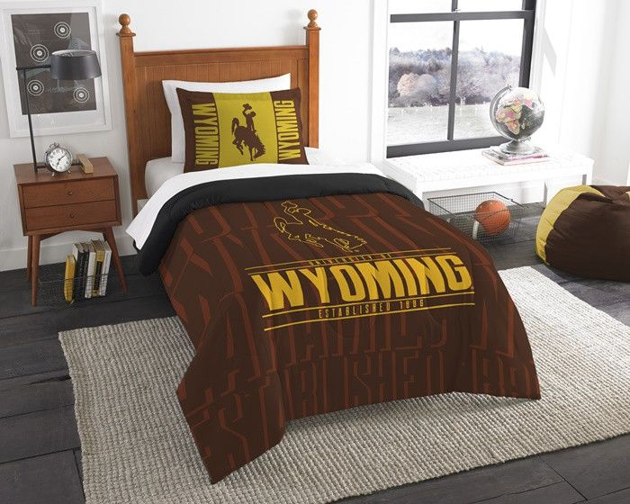 Wyoming Cowboys Modern Take Twin Comforter Set. Includes 1 Sham and 1 Twin Comforter. Visit SportsFansPlus.com for Details.