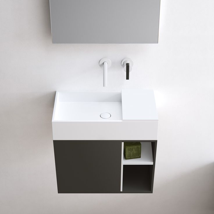 Edge, simple yet sophisticated and characterised by its minimalist rectangular appearance and thin 12mm edge. A completely (hand) made to measure basin out of HI-MACS (solid surface). This basic-shaped basin is ideal for design purposes and easily adaptable. Featured: Edge hand rinse basin in Alpine white HI-MACS on top of a Fenix NTM wall mounted cabinet. Create a small countertop with our HI-MACS Cover. bathsbyclay.com