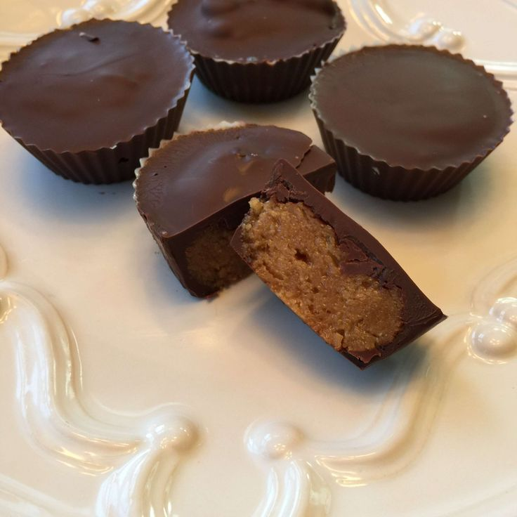 Ingredients: 3 cups Protein Factory Native Whey Isolate-Vanilla 2 cups60%CacaoBittersweet Chocolate Chips 1 cup Peanut Butter ¾ Unsweetened Almond Milk ¾ cup PB2 Powder 3 Tablespoons Vanilla  Directions: In large bowl add protein powder, peanut butter, almond milk, PB2, almond milk and vanilla. Mix well. In medium size microwave safe bowl pour in chocolate chips. Microwave in 30 second increments, stirring every 30 seconds until chips are melted. Spray silicone cupcake cups with coconut…