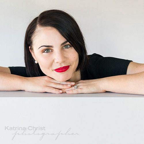 Catherine , my digital retoucher rocking the red lippy as she does. Updated head shots for us here in the studio, Using stunning window lighting. head shots with STYLE  Corporate photographer Brisbane