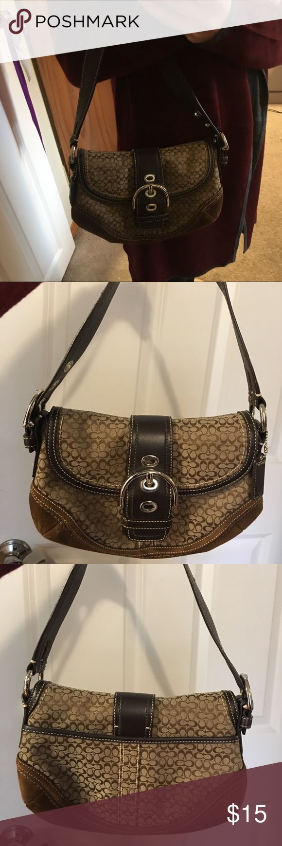 Small brown Coach purse This is a small Coach purse. It has a small stain on the corner as seen in the picture but is otherwise clean. Coach Bags
