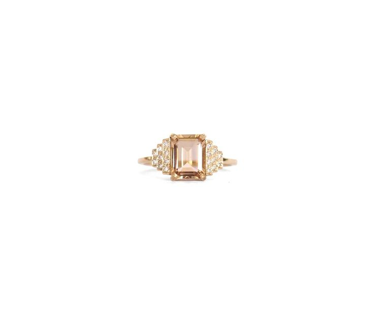 An emerald cut champagne quartz framed with steps of white diamonds. Created in sterling silver, 14ct gold or rose gold. * Please note all Natalie Marie pieces
