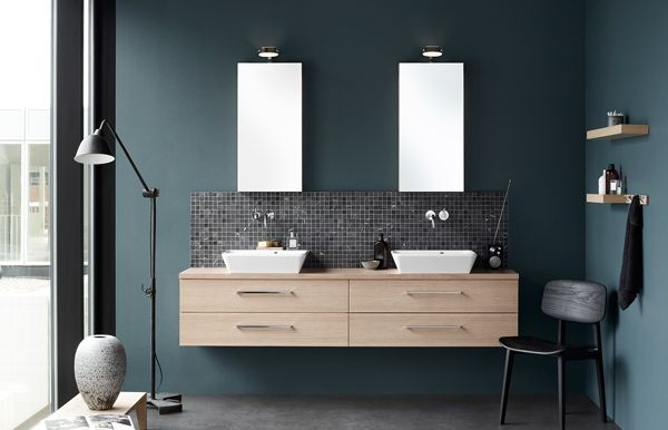 Remove one washbasin and one mirror cabinet and create a asymmetric solution instead.
