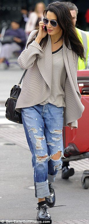 Trendy: The 32-year-old wore a pair of ripped jeans and a loose, comfy looking cardigan...