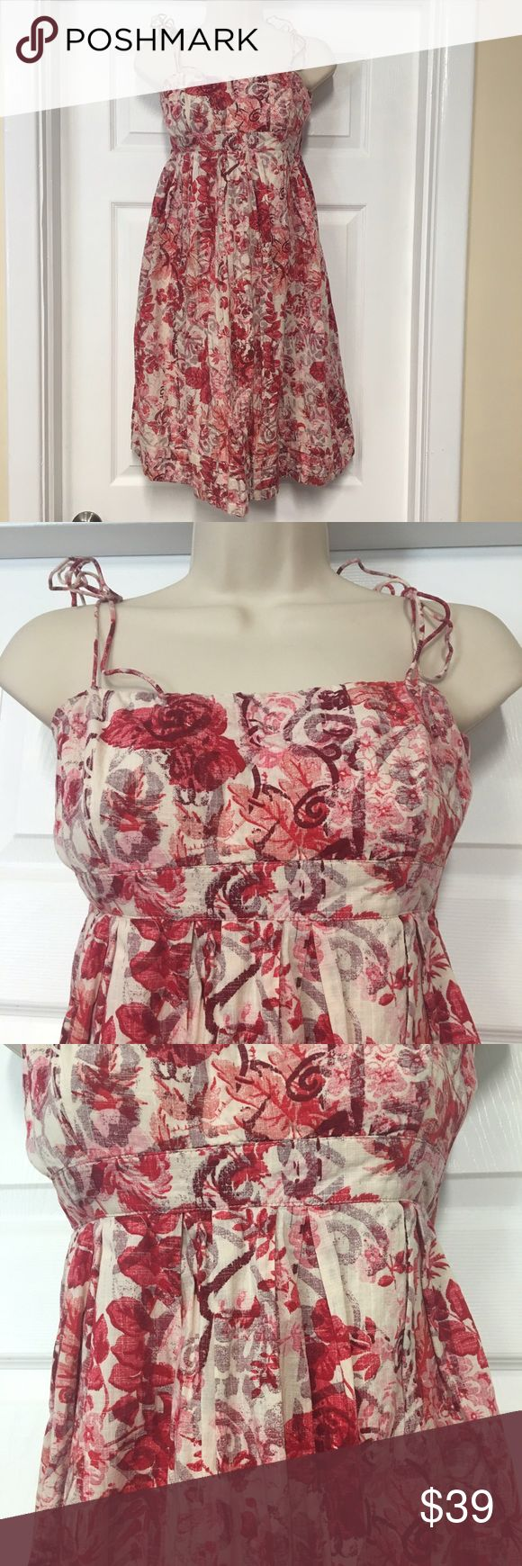 GAP Red and white floral spaghetti strap sundress Beautiful sundress. Perfect for a vacation or a lunch date. Pier with some cute sandals or wedges and a widebrimmed hat for a great look. Add heels to dress up! This dress is from the gap it is a size 6 and it is 100% cotton shell and lining. Straps tie so you can adjust them. Very flattering fit in an effortless summer look GAP Dresses Midi