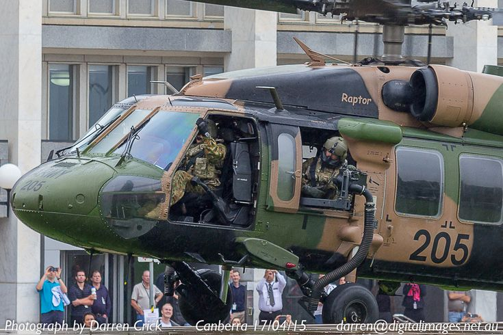 An Australian Army Blackhawk operates between office building and memorial at Russell Offices in #Canberra 17/04/15 #avgeek #aeroausmag #CBR