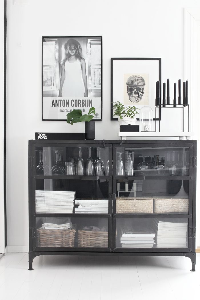iron industrial cabinet with glass doors art white wall and white floor.
