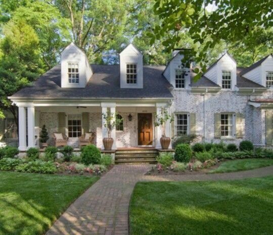 """Beautiful brick on this gorgeous home done in a """"german smear"""" technique."""