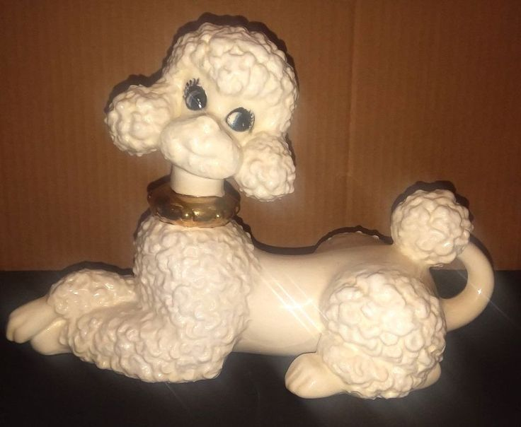 VINTAGE BEAUTIFUL WHITE POODLE WITH A GOLD COLLAR, BLUE EYES AND BIG EYELASHES