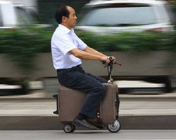 chinese farmer builds a fully-functioning suitcase scooter.  BRILLIANT.