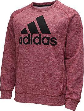 """Este es un suéter en mi tiempo libre. El color de suéter es rojo y el logo del suéter es Adidas. Mis amigos le gustan compran ropas con la marca """"Adidas""""."""